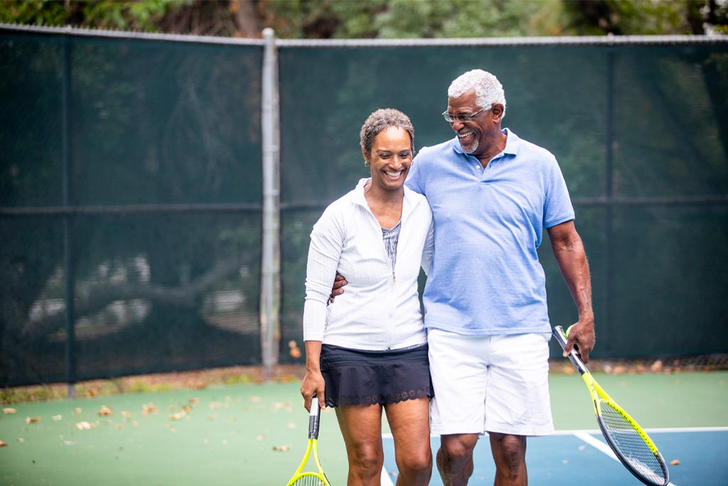 A man and a woman playing tennis together.